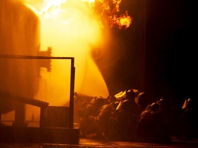 Firefighters battling and industrial fire gas detectors
