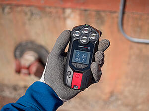 G7c-quad-in-gloved-hand-with-concrete-background-400w